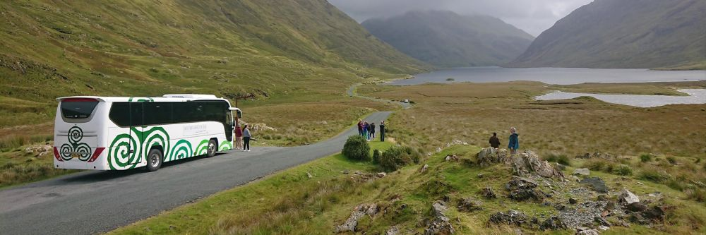 Private tour bus for ireland in the mountains