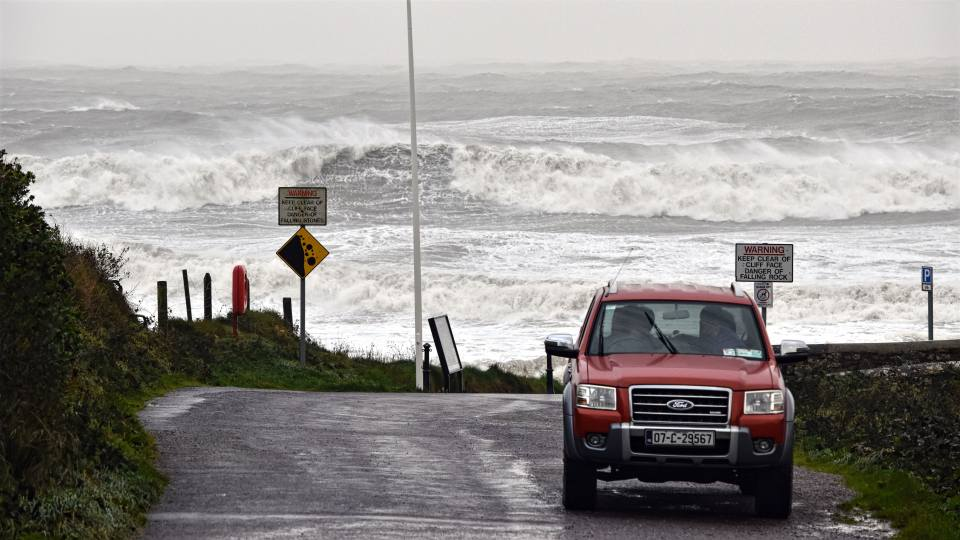 A ford truck with giant waves Storm Ophelia in 2017