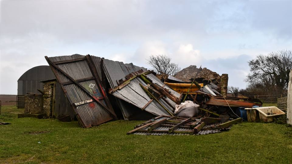 a shed that has been badly damaged during storm Ophelia
